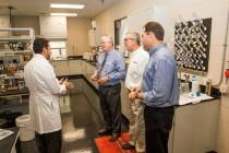 Congressman Joe Barton gets a tour of Magnablend's Research & Development Laboratory. (L - R) Dr. Abdel Rahy - Research and Development Senior Chemist, Barton, Donnie Lord - SSC Plant Manager, Scott Pendery - Magnablend President & CEO. (Photo: PRNewsFoto/Magnablend, Inc.)